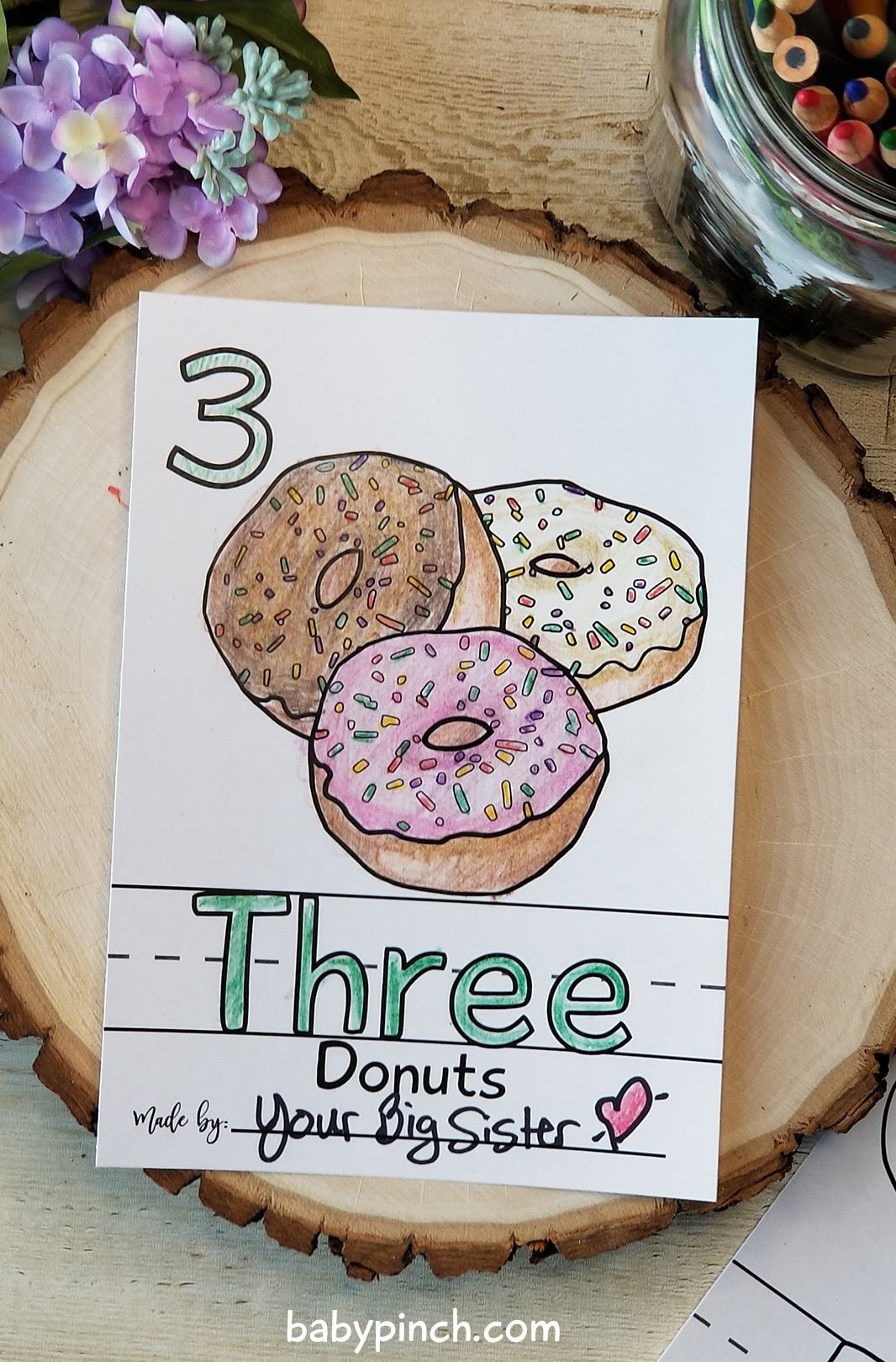 Number 3 page with three donuts