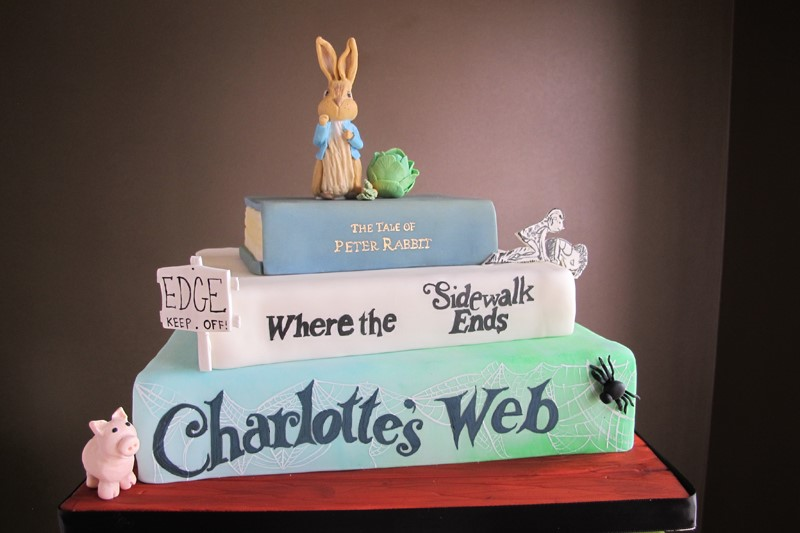 Peter rabbit baby shower cake with stack of books